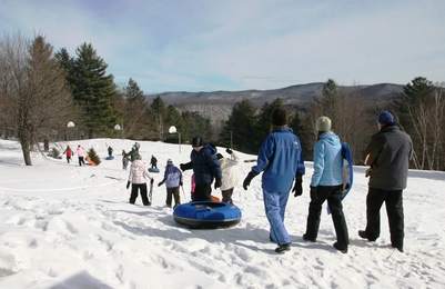 Campers walking toward the tubing run 3